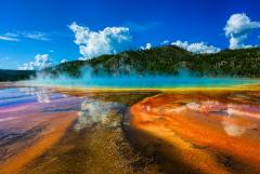 Grand Prismatic Spring on a Yellowstone tour on a beautiful summer's day.