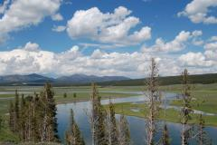 The Yellowstone River runs through the Hayden Valley on a Yellowstone tour.